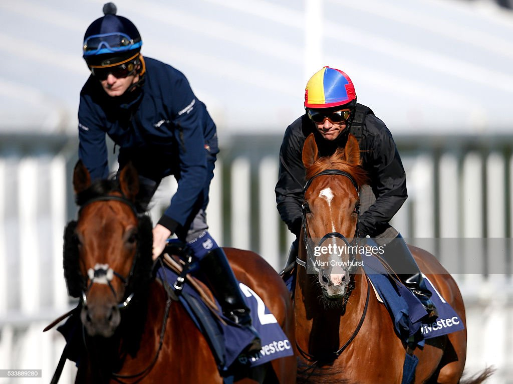 <a gi-track='captionPersonalityLinkClicked' href=/galleries/search?phrase=Frankie+Dettori&family=editorial&specificpeople=167142 ng-click='$event.stopPropagation()'>Frankie Dettori</a> riding Wings Of Desire (R) during the 'Breakfast with the Stars' morning at Epsom Racecourse on May 24, 2016 in Epsom, England.