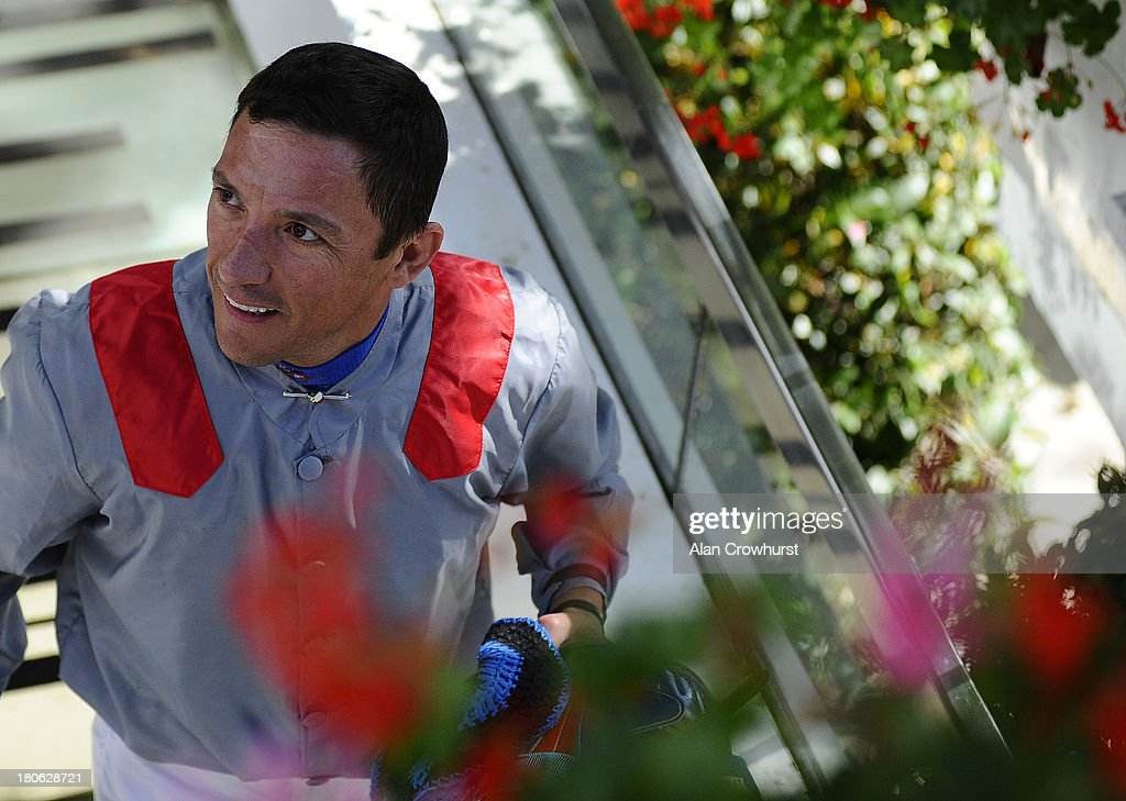 <a gi-track='captionPersonalityLinkClicked' href=/galleries/search?phrase=Frankie+Dettori&family=editorial&specificpeople=167142 ng-click='$event.stopPropagation()'>Frankie Dettori</a> smiles after he wins The Qatar Prix Vermeille at Longchamp racecourse on September 15, 2013 in Paris, France.