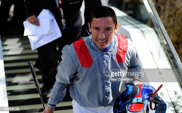 Frankie Dettori smiles after he wins The Qatar Prix Vermeille at Longchamp racecourse on September 15 2013 in Paris France