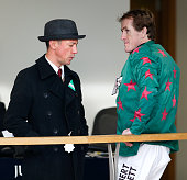 Frankie Dettori talks with fellow jockey Tony McCoy as he attends the Clarence House Chase Raceday at Ascot Racecourse on January 17 2015 in Ascot...
