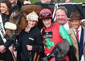 Frankie Dettori the breeder of Dodging Bullets celebrates with Sam TwistonDavies after victory in the Betway Queen Mother Champion Steeple Chase...