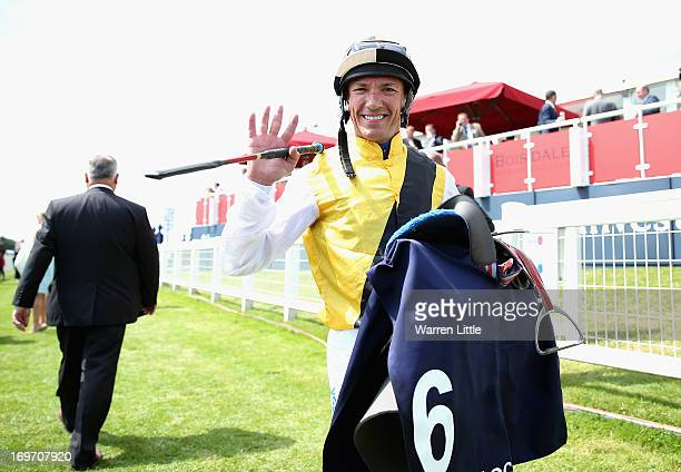 Frankie Dettori waves to the camera after finishing The Investec Diomed Stakes and his last race of the day during Epsom Races at Epsom Racecourse on...