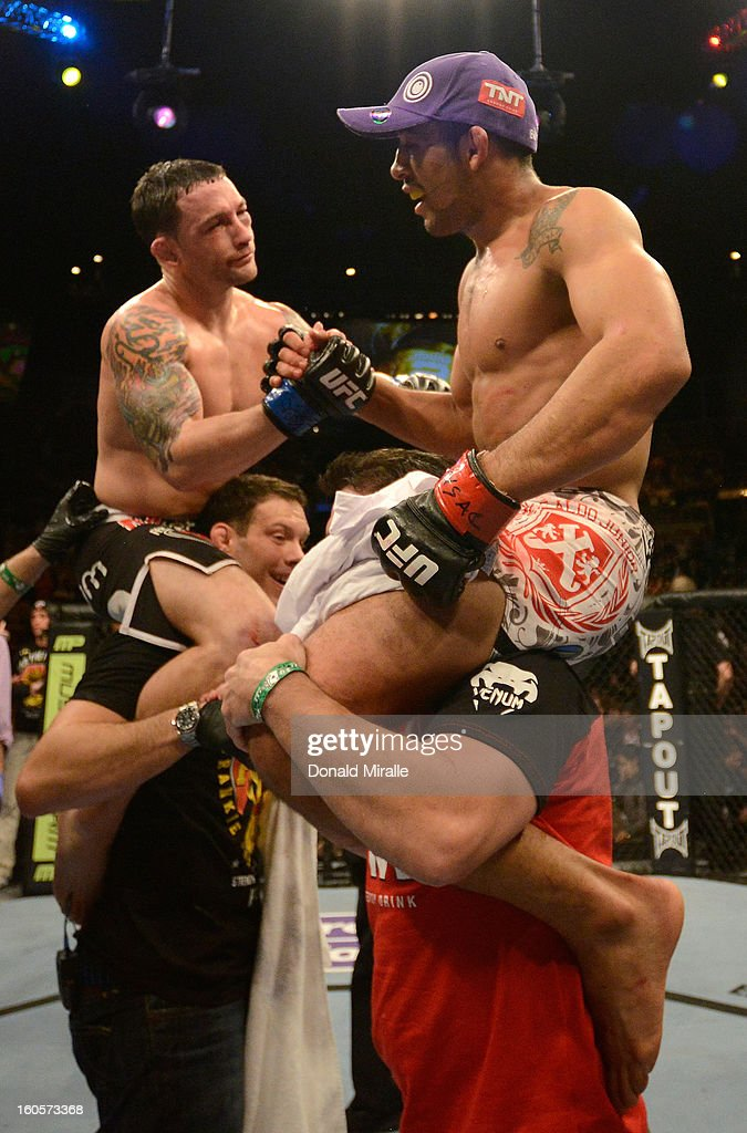 <a gi-track='captionPersonalityLinkClicked' href=/galleries/search?phrase=Frankie+Edgar&family=editorial&specificpeople=5446046 ng-click='$event.stopPropagation()'>Frankie Edgar</a> (upper left) and <a gi-track='captionPersonalityLinkClicked' href=/galleries/search?phrase=Jose+Aldo&family=editorial&specificpeople=6912631 ng-click='$event.stopPropagation()'>Jose Aldo</a> (upper right) congratulate eachother after their featherweight title fight at UFC 156 on February 2, 2013 at the Mandalay Bay Events Center in Las Vegas, Nevada.