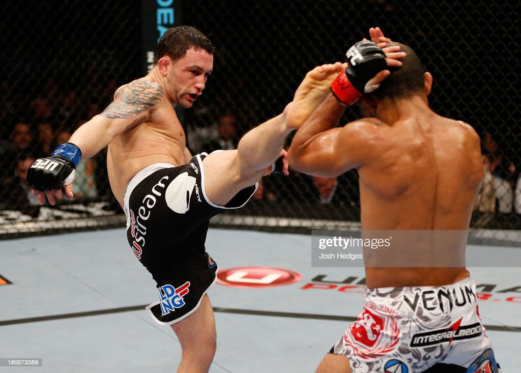 Frankie Edgar kicks Jose Aldo during their featherweight title fight at UFC 156 on February 2, 2013 at the Mandalay Bay Events Center in Las Vegas, Nevada.