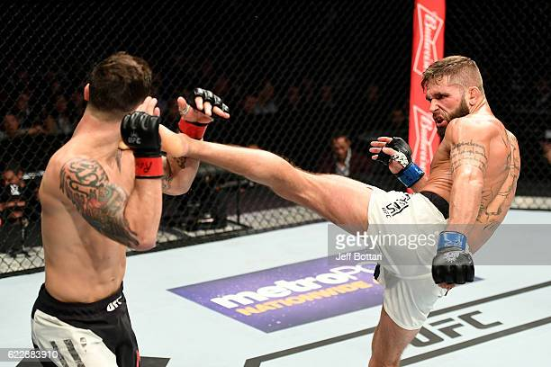 Frankie Edgar of the United States fights against Jeremy Stephens of the United States in their featherweight bout during the UFC 205 event at...