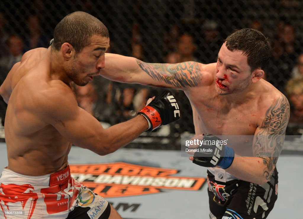 <a gi-track='captionPersonalityLinkClicked' href=/galleries/search?phrase=Frankie+Edgar&family=editorial&specificpeople=5446046 ng-click='$event.stopPropagation()'>Frankie Edgar</a> punches <a gi-track='captionPersonalityLinkClicked' href=/galleries/search?phrase=Jose+Aldo&family=editorial&specificpeople=6912631 ng-click='$event.stopPropagation()'>Jose Aldo</a> during their featherweight title fight at UFC 156 on February 2, 2013 at the Mandalay Bay Events Center in Las Vegas, Nevada.