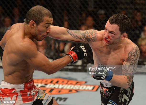 Frankie Edgar punches Jose Aldo during their featherweight title fight at UFC 156 on February 2 2013 at the Mandalay Bay Events Center in Las Vegas...