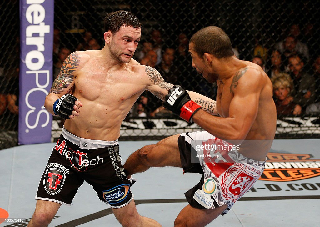 Frankie Edgar punches Jose Aldo during their featherweight title fight at UFC 156 on February 2, 2013 at the Mandalay Bay Events Center in Las Vegas, Nevada.