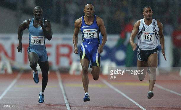 Frankie Fredericks of Namibia powers to the line ahead of second place Jason Gardener and fourth place Aziz Zakari of Ghana during the mens 100...