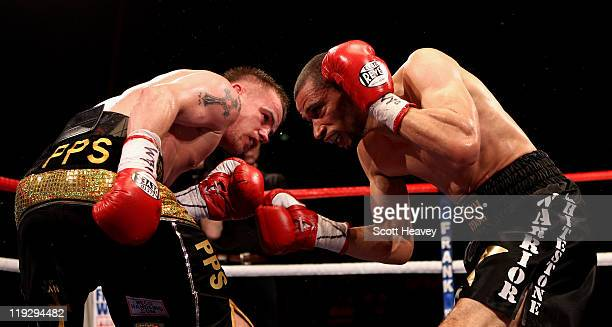 Frankie Gavin battles with Curtis Woodhouse during the WBO Intercontinental Welterweight Championship bout bout at Echo Arena on July 16 2011 in...