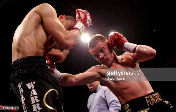 Frankie Gavin of England connects with Curtis Woodhouse of England during the WBO Intercontinental Welterweight Championship bout at Echo Arena on...