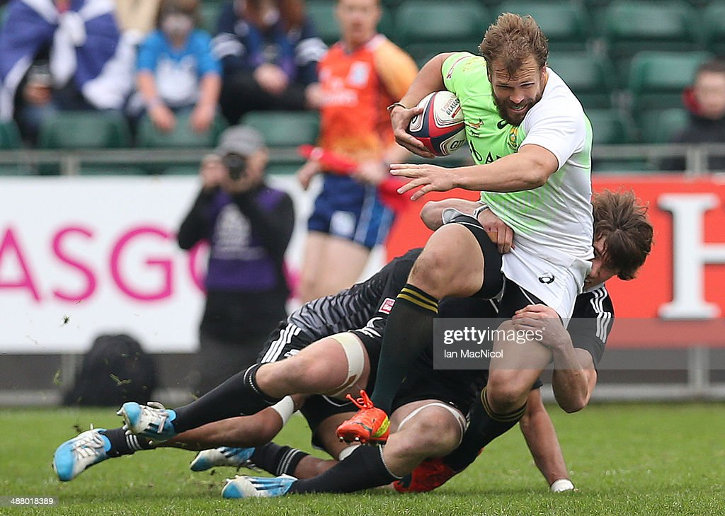 Frankie Horne of South Africa is tackled by <a gi-track='captionPersonalityLinkClicked' href=/galleries/search?phrase=Akira+Ioane&family=editorial&specificpeople=9479095 ng-click='$event.stopPropagation()'>Akira Ioane</a> of New Zealand during the final group game during the IRB Glasgow Sevens at Scotstoun Stadium on May 3, 2014 in Glasgow, Scotland.