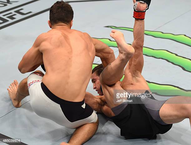 Frankie Perez of the United States punches Sam Stout in their lightweight bout during the UFC event at the SaskTel Centre on August 23 2015 in...