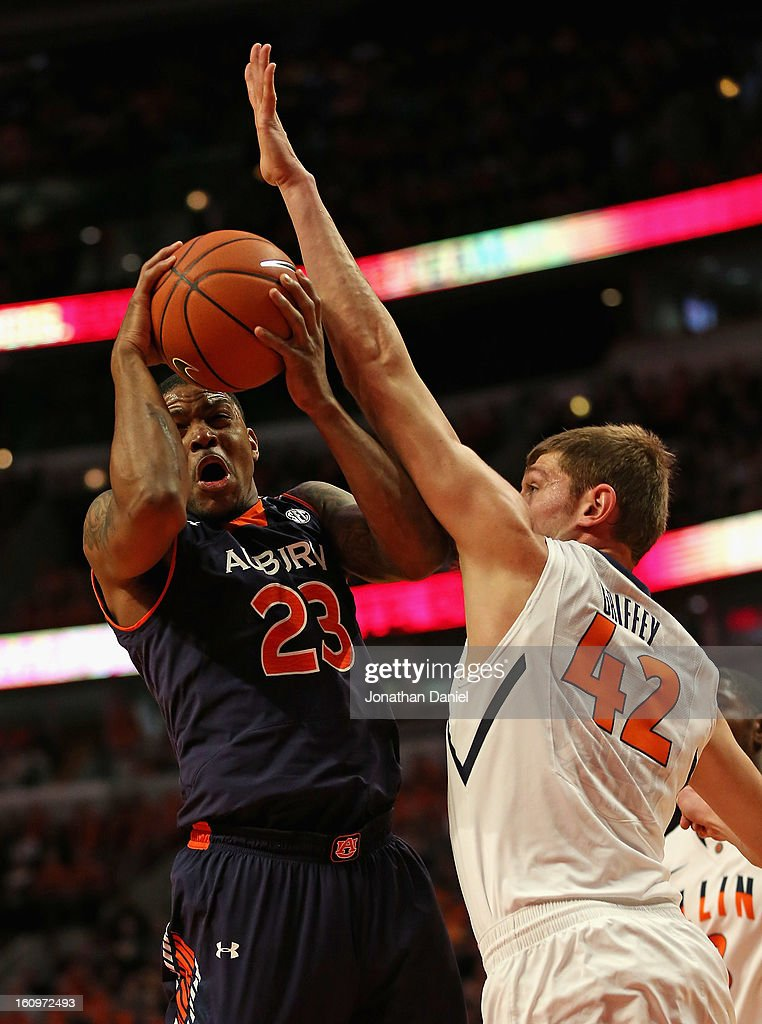 Frankie Sullivan #23 of the Auburn Tigers is fouled by Tyler Griffey #42 of the Illinois Fighting Illini at United Center on December 29, 2012 in Chicago, Illinois. Illinois defeated Auburn 81-79.