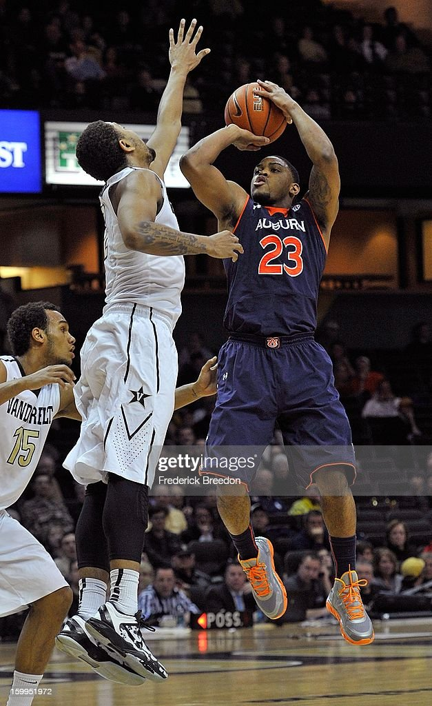 Frankie Sullivan #23 of the Auburn Tigers takes a shot over Kedren Johnson #2 of the Vanderbilt Commodores at Memorial Gym on January 23, 2013 in Nashville, Tennessee.