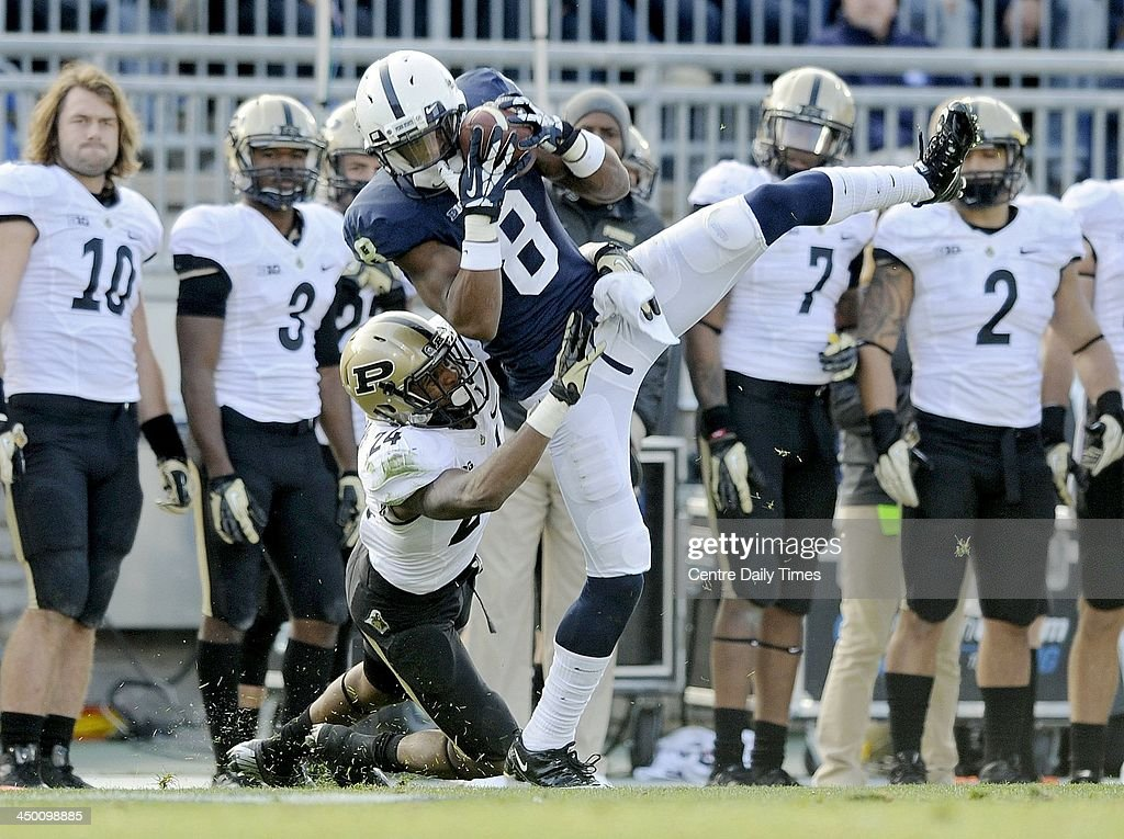 Frankie Williams of Purdue pulls down Allen Robinson of Penn State on a pass reception. The Penn State Nittany Lions defeated the Purdue Boilermakers, 45-21, at Beaver Stadium in State College, Pa., on Saturday, Nov. 16, 2013.