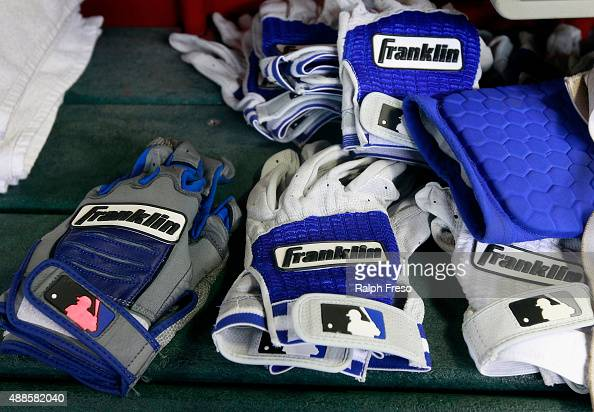 Frankin batting gloves inside the dugout of the Los Angeles Dodgers during a MLB game against the Arizona Diamondbacks at Chase Field on September 12...