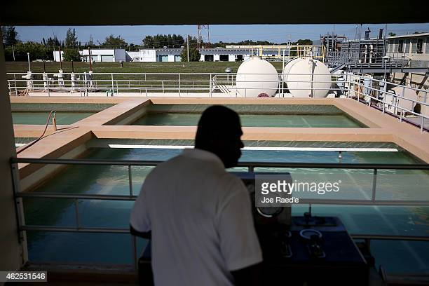Franklin Alexander Treatment Plant Operator 2 of the Miami Dade County Water Systems Operations clears a water holding tank as the MiamiDade county...