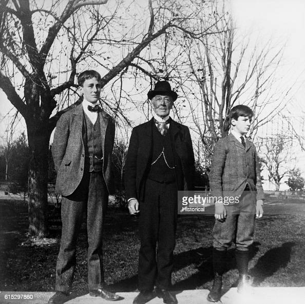 Franklin D Roosevelt his father James and Warren G Robbins at the Groton School in Groton Massachusetts where Roosevelt was a student