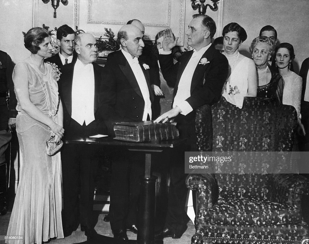 Franklin D. Roosevelt takes oath of office on family bible for second term as governor of New York.