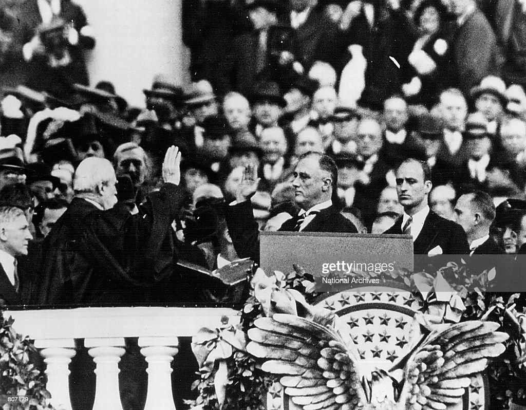 Franklin D Roosevelt takes the Oath of Office as President of the United States in January 20 1933 in Washington DC