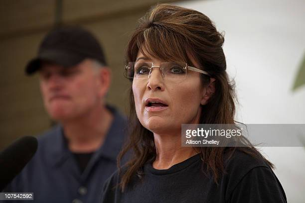 Franklin Graham and Sarah Palin hold a press conference in a supply warehouse on the grounds of the Samaritan's Purse compound on December 12 2010...