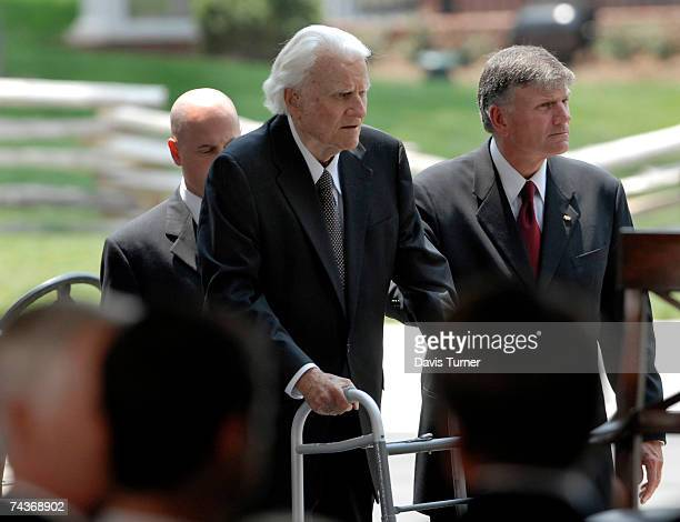 Franklin Graham helps his father Billy Graham to the stage during the Billy Graham Library Dedication Service on May 31 2007 in Charlotte North...