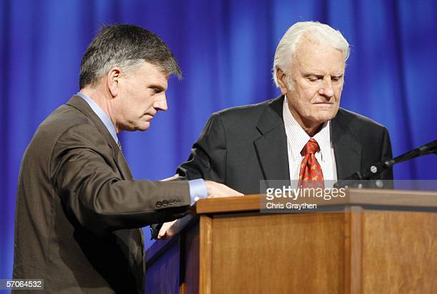 Franklin Graham helps his father Billy to the podium before preaching during the Celebration of Hope on March 12 2006 at the New Orleans Arena in New...