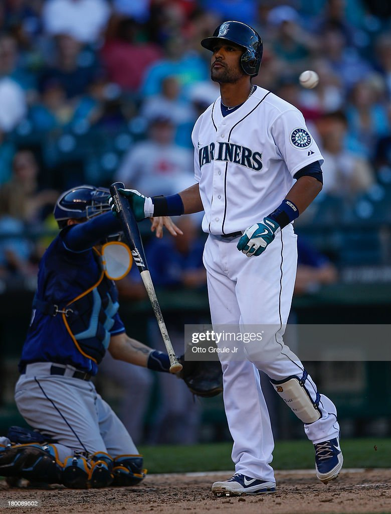 <a gi-track='captionPersonalityLinkClicked' href=/galleries/search?phrase=Franklin+Gutierrez&family=editorial&specificpeople=837650 ng-click='$event.stopPropagation()'>Franklin Gutierrez</a> #21 of the Seattle Mariners heads back to the dugout after striking out with two runners on base for the second out of the eighth inning against the Tampa Bay Rays at Safeco Field on September 8, 2013 in Seattle, Washington. The Rays defeated the Mariners 4-1.
