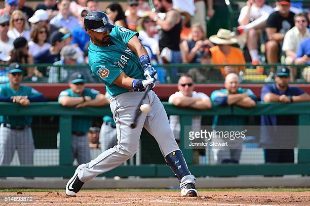 Franklin Gutierrez of the Seattle Mariners hits an RBI double in the third inning of the spring training game against the San Francisco Giants at...