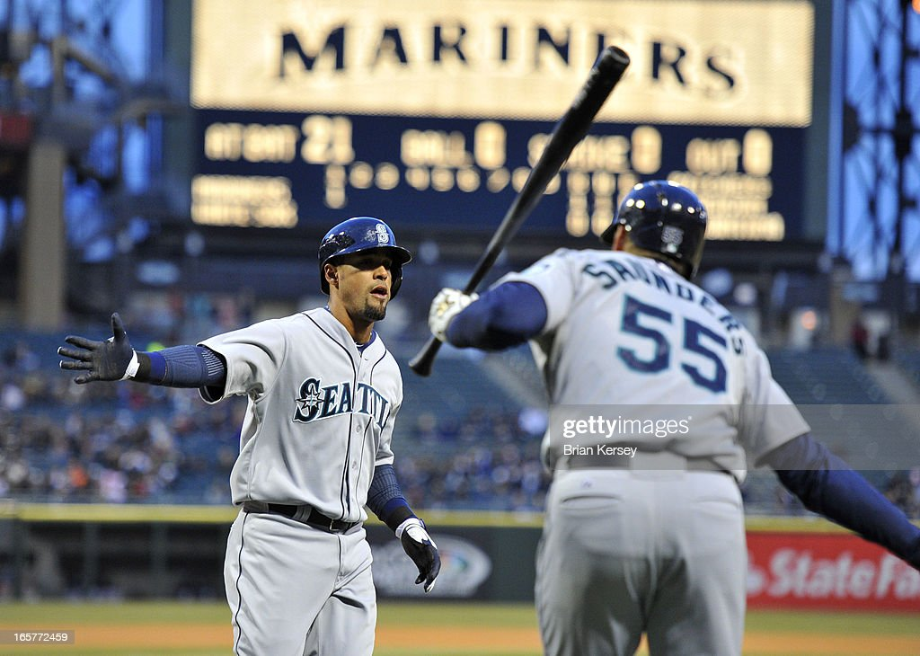 Franklin Gutierrez #21 of the Seattle Mariners (L) is congratulated by teammate Michael Saunders #55 after hitting a solo home run during the first inning against the Chicago White Sox on April 5, 2012 at U.S. Cellular Field in Chicago, Illinois.