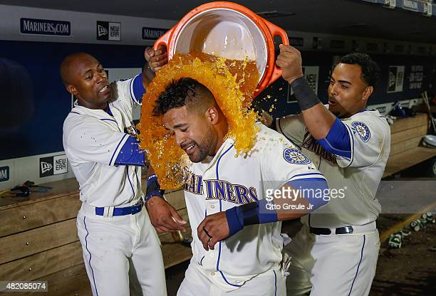 Franklin Gutierrez of the Seattle Mariners is doused by teammates after hitting a walkoff home run to defeat the Toronto Blue Jays 65 in ten innings...