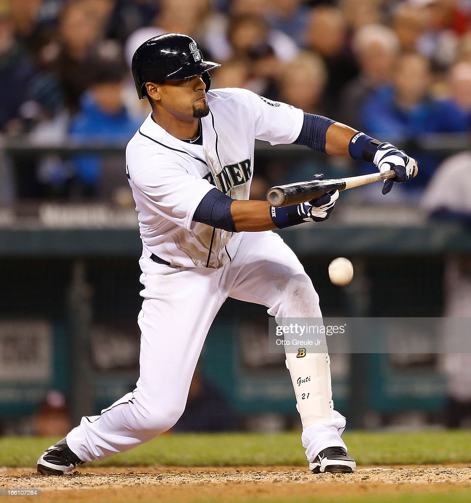 <a gi-track='captionPersonalityLinkClicked' href=/galleries/search?phrase=Franklin+Gutierrez&family=editorial&specificpeople=837650 ng-click='$event.stopPropagation()'>Franklin Gutierrez</a> #21 of the Seattle Mariners puts down a sacrifice RBI bunt in the fifth inning against the Houston Astros on Opening Day at Safeco Field on April 8, 2013 in Seattle, Washington.