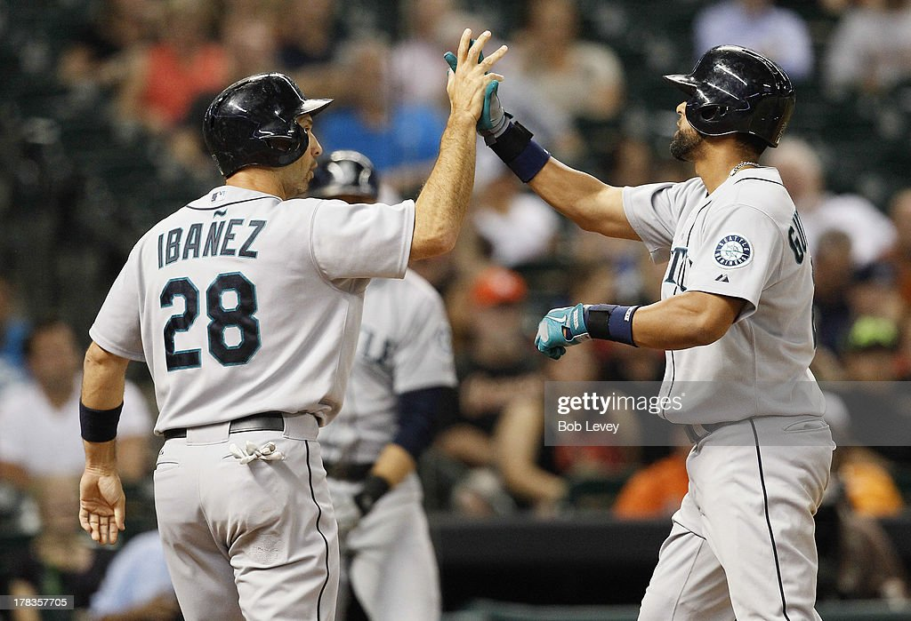 <a gi-track='captionPersonalityLinkClicked' href=/galleries/search?phrase=Franklin+Gutierrez&family=editorial&specificpeople=837650 ng-click='$event.stopPropagation()'>Franklin Gutierrez</a> #21 of the Seattle Mariners receives a high five from <a gi-track='captionPersonalityLinkClicked' href=/galleries/search?phrase=Raul+Ibanez&family=editorial&specificpeople=206118 ng-click='$event.stopPropagation()'>Raul Ibanez</a> #28 after hitting a home run in the fourth inning against the Houston Astros at Minute Maid Park on August 29, 2013 in Houston, Texas.