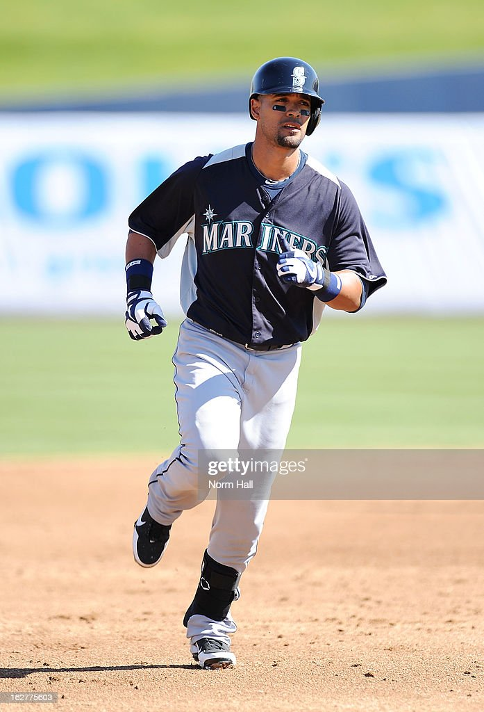 <a gi-track='captionPersonalityLinkClicked' href=/galleries/search?phrase=Franklin+Gutierrez&family=editorial&specificpeople=837650 ng-click='$event.stopPropagation()'>Franklin Gutierrez</a> #21 of the Seattle Mariners rounds the bases after hitting a home run against the Milwaukee Brewers at Maryvale Baseball Park on February 26, 2013 in Maryvale, Arizona.