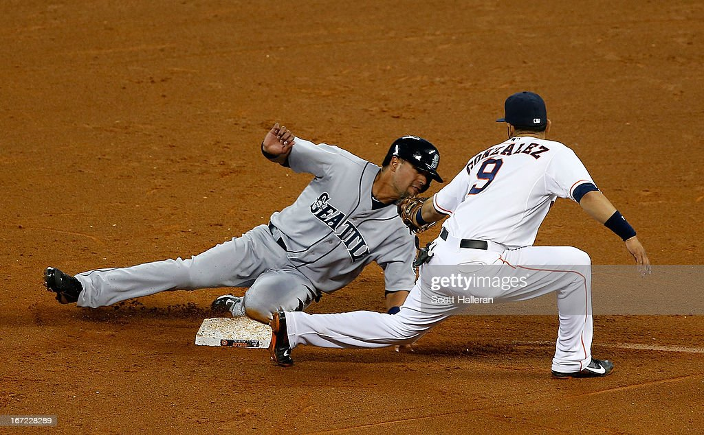 Franklin Gutierrez of the Seattle Mariners steals second in the fourth inning under the tag of Marwin Gonzalez of the Houston Astros at Minute Maid...