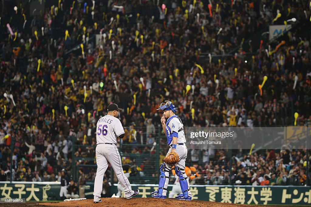 Franklin Morales of Colorado Rockies and Drew Butera of the Los Angeles Dodgers speak during the friendly match between Hanshin Tigers and Yomiuri...