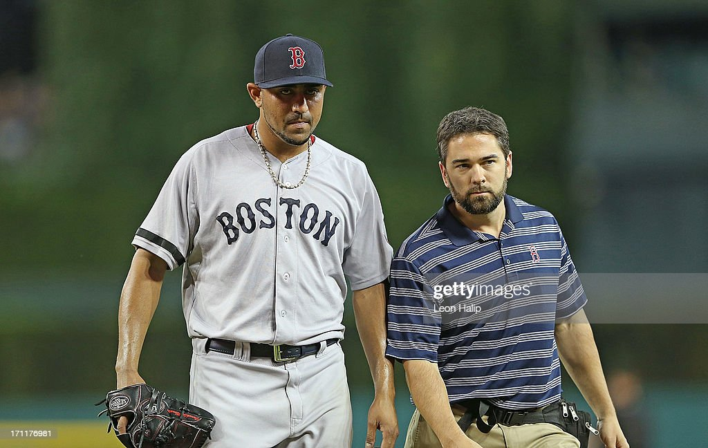 <a gi-track='captionPersonalityLinkClicked' href=/galleries/search?phrase=Franklin+Morales&family=editorial&specificpeople=4175198 ng-click='$event.stopPropagation()'>Franklin Morales</a> #56 of the Boston Red Sox leaves the game in the seventh inning with the trainer during the game against the Detroit Tigers at Comerica Park on June 22, 2013 in Detroit, Michigan. The Tigers defeated the Red Sox 10-3.