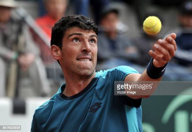Franko Skugor of Croatia serves during a match against Santiago Giraldo of Colombia as part of Davis Cup at La Santamaria Ring Bull on September 15...