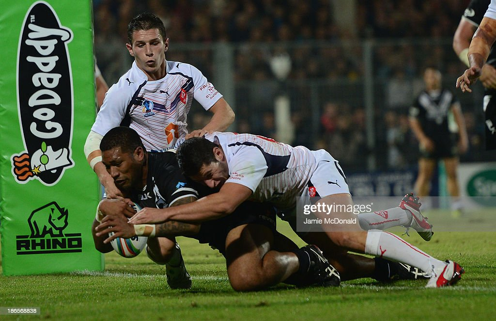 Frank-Paul Nuuausala of New Zealand scores a try during the Rugby League World Cup group B match between New Zealand and France at Parc des Sports on November 1, 2013 in Avignon, France.