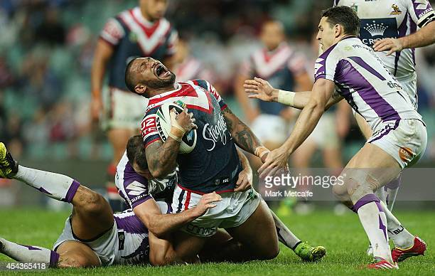 FrankPaul Nuuausala of the Roosters is tackled during the round 25 NRL match between the Sydney Roosters and the Melbourne Storm at Allianz Stadium...