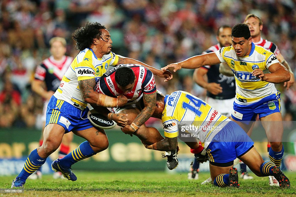 Frank-Paul Nuuausala of the Roosters is tackled during the round four NRL match between the Sydney Roosters and the Parramatta Eels at Allianz Stadium on April 1, 2013 in Sydney, Australia.