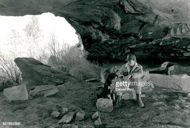 Franktown rancher Chip Newton and his border Collie Fergie Sit in the cave on his property in which Indian artifacts dating to 900 AD have been found...
