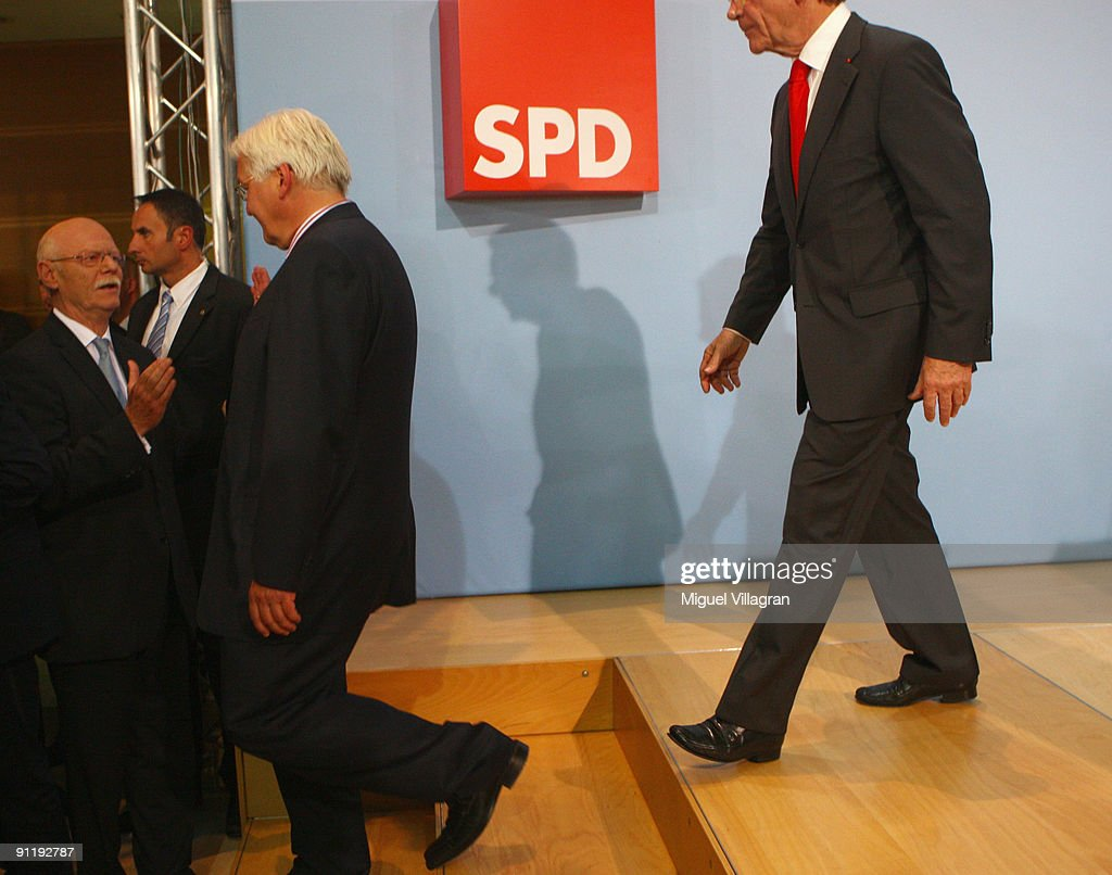 <a gi-track='captionPersonalityLinkClicked' href=/galleries/search?phrase=Frank-Walter+Steinmeier&family=editorial&specificpeople=603500 ng-click='$event.stopPropagation()'>Frank-Walter Steinmeier</a> (C), candidate of the Social Democratic Party in German Federal Elections, greets <a gi-track='captionPersonalityLinkClicked' href=/galleries/search?phrase=Peter+Struck&family=editorial&specificpeople=745150 ng-click='$event.stopPropagation()'>Peter Struck</a>, parliamentary group leader of Germany's social democratic party while SPD Chairman <a gi-track='captionPersonalityLinkClicked' href=/galleries/search?phrase=Franz+Muentefering&family=editorial&specificpeople=214167 ng-click='$event.stopPropagation()'>Franz Muentefering</a> follows as they attend the Election Night Party after first projections at the SPD headquarter on September 27, 2009 in Berlin, Germany. The SPD had to pocket massive losses reaching 23.1 percent.