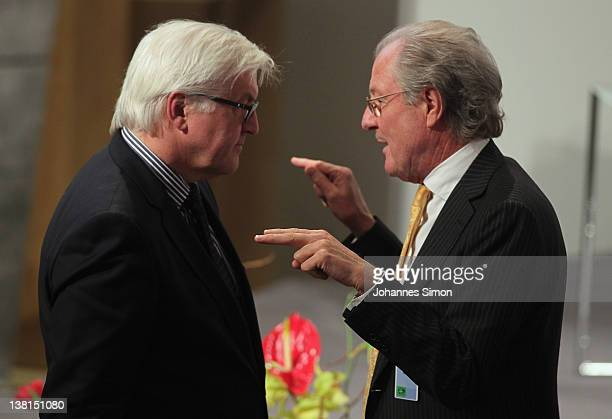 FrankWalter Steinmeier chairman of the German Social Demoractic Party SPD parliamentary group and Wolfgang Reitzle CEO of Linde AG chat together...