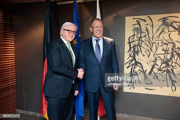 FrankWalter Steinmeier German minister of foreign affairs and Russian minister of foreign affairs Sergey V Lavrov shake hands ahead of a bilateral...