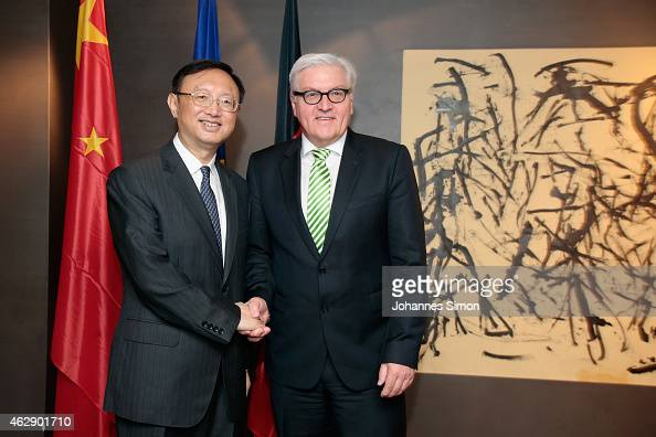 FrankWalter Steinmeier German minister of foreign affairs and Yang Jiechi state councilor of the People's Republic of China shake hands ahead of a...