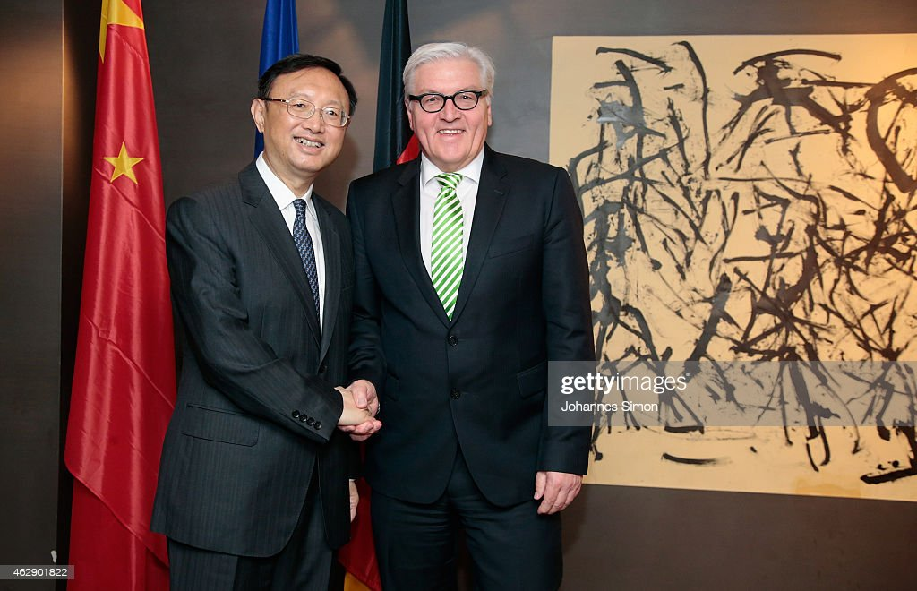 Frank-Walter Steinmeier (R), German minister of foreign affairs and Yang Jiechi, state councilor of the People's Republic of China shake hands ahead of a bilateral meeting at the 51st Munich Security Conference (MSC) on February 7, 2015 in Munich, Germany. Foreign ministers and defense ministers from countries across the globe are meeting to discuss current global security issues, in particular the crisis in eastern Ukraine, the spread of ISIS in Syria and Iraq and the large-scale movement and plight of refugees.