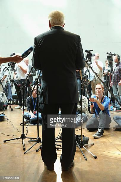 FrankWalter Steinmeier German Social Democrat speaks to the media after the government cancelled an offer for Steinmeier to testify at a hearing of...