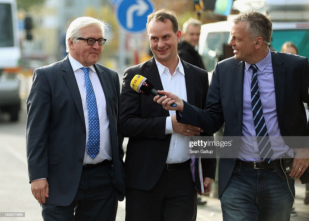 <a gi-track='captionPersonalityLinkClicked' href=/galleries/search?phrase=Frank-Walter+Steinmeier&family=editorial&specificpeople=603500 ng-click='$event.stopPropagation()'>Frank-Walter Steinmeier</a> (L), head of the Bundestag faction of the German Social Democrats (SPD), arrives for coalition negotiations at the headquarters of the German Christian Democrats (CDU) on October 23, 2013 in Berlin, Germany. The CDU and SPD are meeting for the first day of negotiations in order to create a new coalition government following recent elections in Germany.